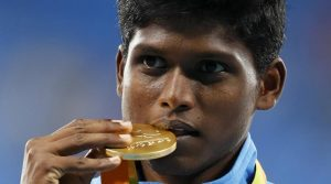 2016 Rio Paralympics - Men's High Jump - T42 Final - Olympic Stadium - Rio de Janeiro, Brazil - 09/09/2016. Mariyappan Thangavelu of India celebrates with his gold medal during the victory ceremony. REUTERS/Jason Cairnduff